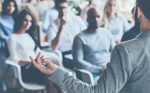 Here to help business seminar Shutterstock